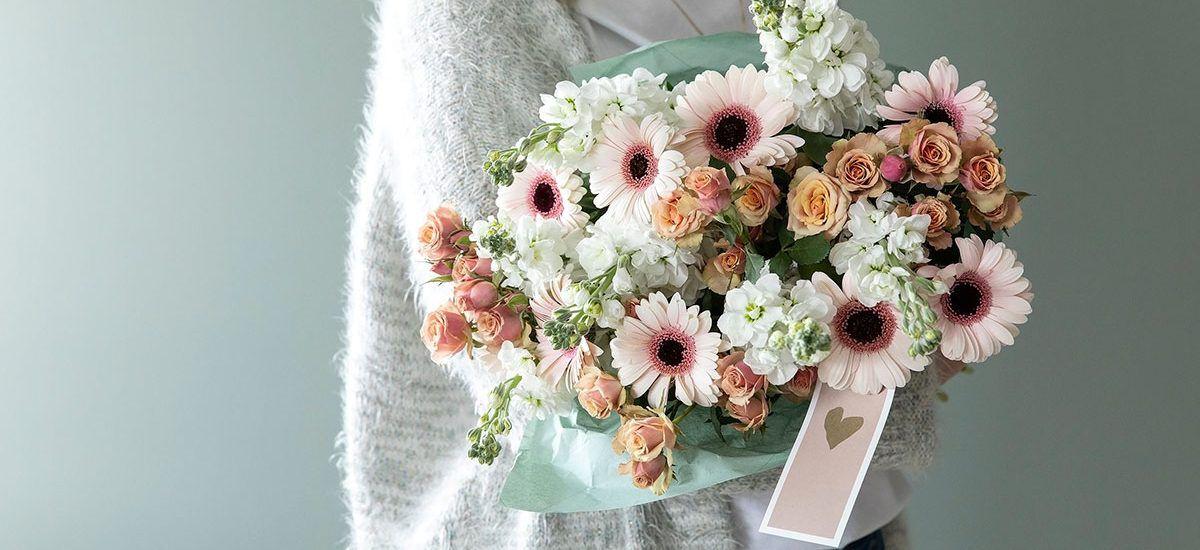 si takk med blomster