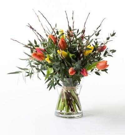 Tulipanbukett med gåsunger i varme farger