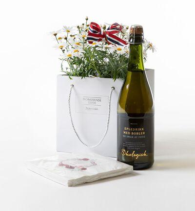 Margeritt i gavepose med drikke