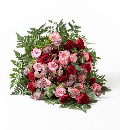 Miljøvennlig bårebukett i rosa og rødt