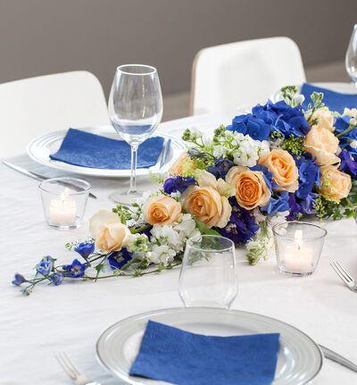 Avlang borddekorasjon i fersken, blått og lime