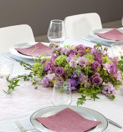 Rund borddekorasjon i lillatoner