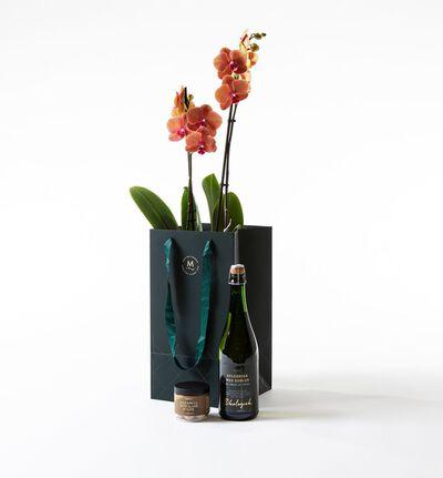 Gyllen orkidé i gavepose